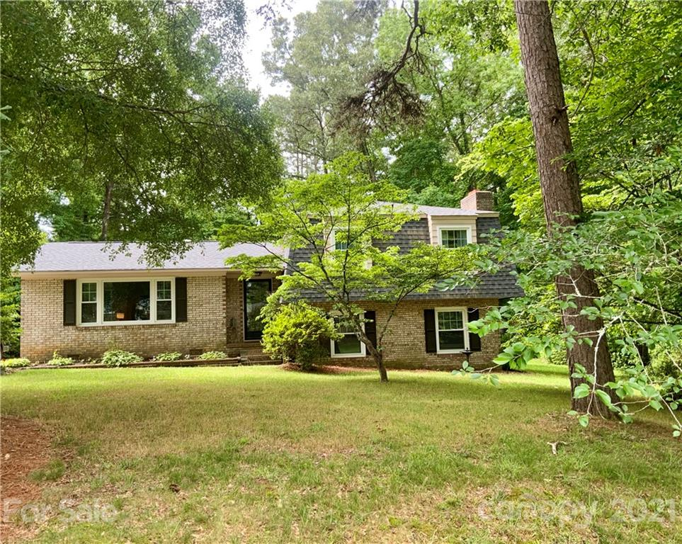 If you are looking for a home with no HOA, county taxes, move-in ready, a large lot that backs to trees, and in a location close to the interstate, shopping & restaurants, this is it! This home has been well cared for with a new roof & windows in 2019, vinyl plank flooring in 2019, new carpet, some fresh paint, and updated bathrooms. Refrigerator, washer, dryer, and 2 storage buildings stay. Property being sold as-is. Preapproval required. Showings begin at 10:00 on Saturday, June 12. Open House June 12 from 12-3.
