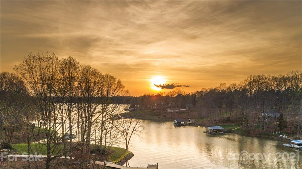 Retreat to paradise!  Beautiful expansive 1.65 acre Lakefront lot on secluded cove of Lake Norman.  Enjoy spectacular sunsets, fishing, and great paddlesport launch area at the water's edge. This lot is being offered by the original owners in conjunction with the sale of their primary home which is adjacent to this lot.  Nature lovers will enjoy the privacy of this lot and area while not being far from major shopping, dining and interstates.  Please call listing agent for more details.