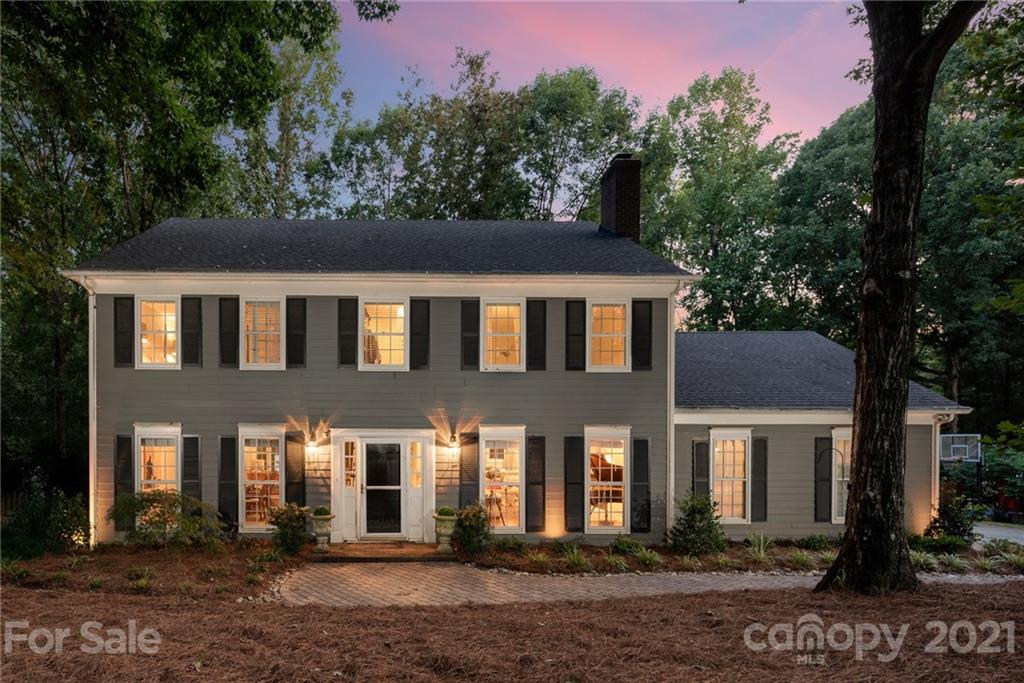 Beautiful traditional home has been completely updated with new carpet throughout. Hardwoods on main