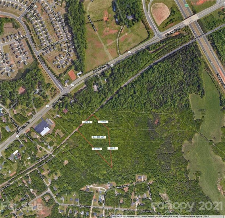 Excellent opportunity in booming Mint Hill. Directly in the path of growth for the HWY 24/27 Corridor. Two large parcels combined almost 12 acres! Gently sloped, beautiful wooded lots, great potential! City water available, sewer will have to be a septic (new city sewer available). Currently two separate lots. Potential to subdivide into 3 or 4 lots (via easement access), must confirm with Mint Hill. Undeveloped nook surrounding by development, this area is poised for tremendous growth.