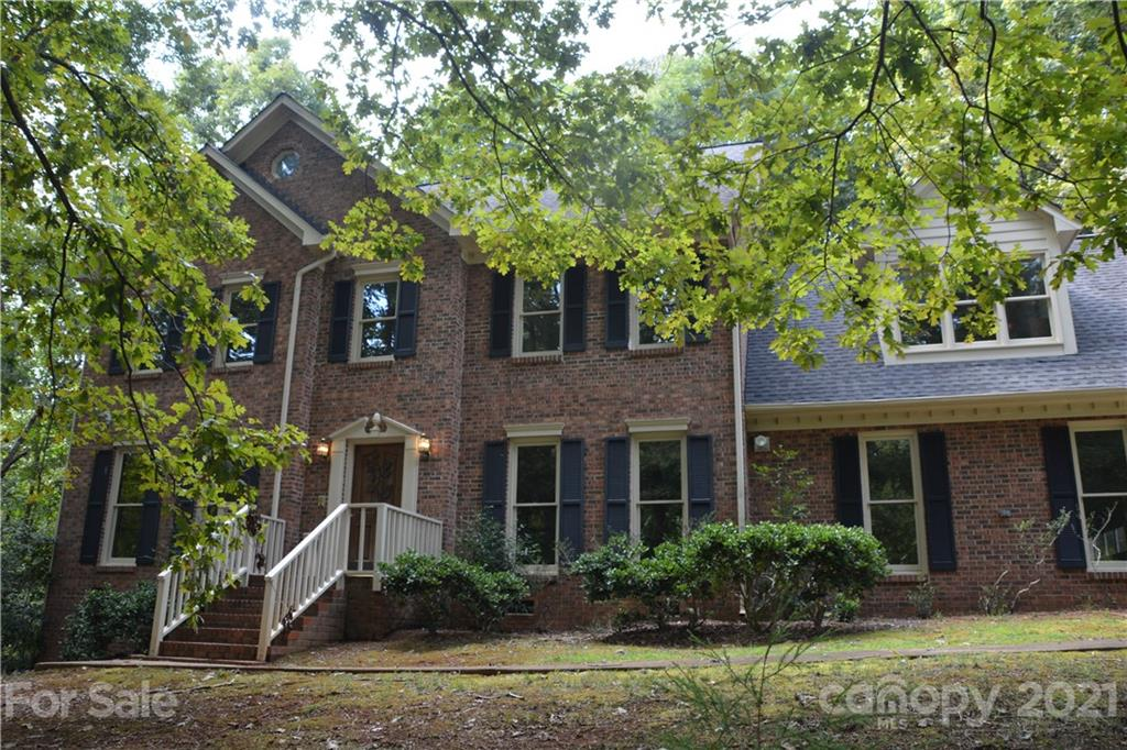 Large four-bedroom, three-and-a-half bath, family home, located in well-established neighborhood, close to UNC Charlotte, shopping, newly developed light rail for commute into downtown. Enter the home through the front door & relax in the living room suited with fireplace, hardwood flooring & windows overlooking the outside deck & yard. Walk through to the breakfast nook, w/ access to kitchen & entrance to very large 2-car garage storage or toys.. Well-sized dining room is located to the right of the home entrance w/ space for large dining table for entertaining. 3rd Floor flex area can easily be converted to a 4th bedroom w/ separate loft area to create your own sanctuary.  If your back woods are not enough you have Reedy Creek Park right