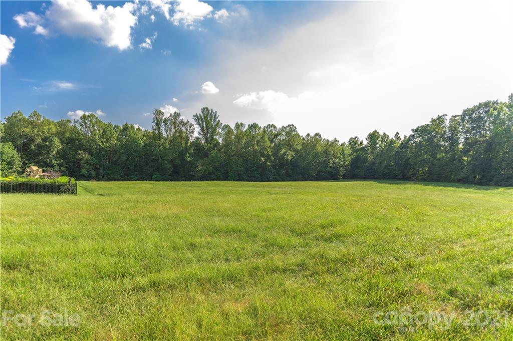 New Salem Estates is a top quality subdivision in the Cool Springs area of Statesville.  County water and septic.  Utilities are stubbed out at the lots.   Large lots provide gracious spacing between homes that are/ and will be, valued between $400,000 to $550,000 and up.  CC&R's and architectural review restrictions are to protect property values.  Plans to be reviewed by owner prior to acceptance.  Lot 12 is one of the very largest lots in the subdivision.  Photographs are of the total community, various views. Plenty of room for in-ground pools and outdoor entertainment areas.  Homes are to be brick, stone, stucco, and hardie board.  Several are already erected and prospective buyers are encouraged to take a look at this lovely community