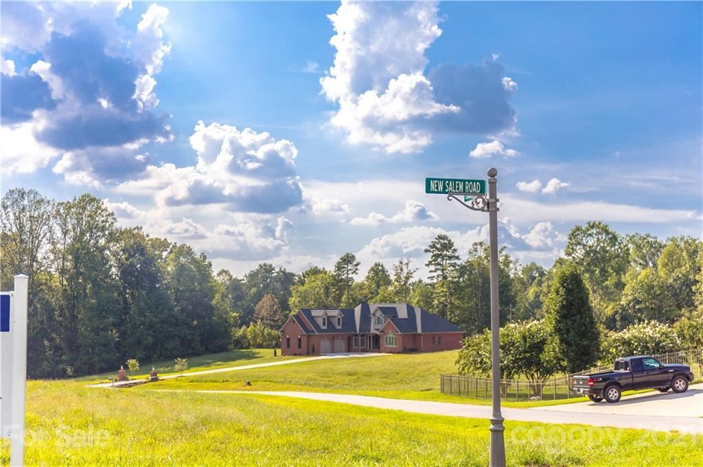 New Salem Estates is a top quality subdivision in the Cool Springs area of Statesville.  County water and septic.  Utilities are stubbed out at the lots.   Large lots provide gracious spacing between homes that are/ and will be, valued between $400,000 to $550,000 and up.  CC&R's and architectural review restrictions are to protect property values.  Plans to be reviewed by owner prior to acceptance.  Lot 13 is the largest lot in the subdivision, and it is a desirable cul de sac lot.  Photographs are of the total community, various views. Plenty of room for in-ground pools and outdoor entertainment areas.  Homes are to be brick, stone, stucco, and hardie board.  Several are already erected and prospective buyers are encouraged to take a look