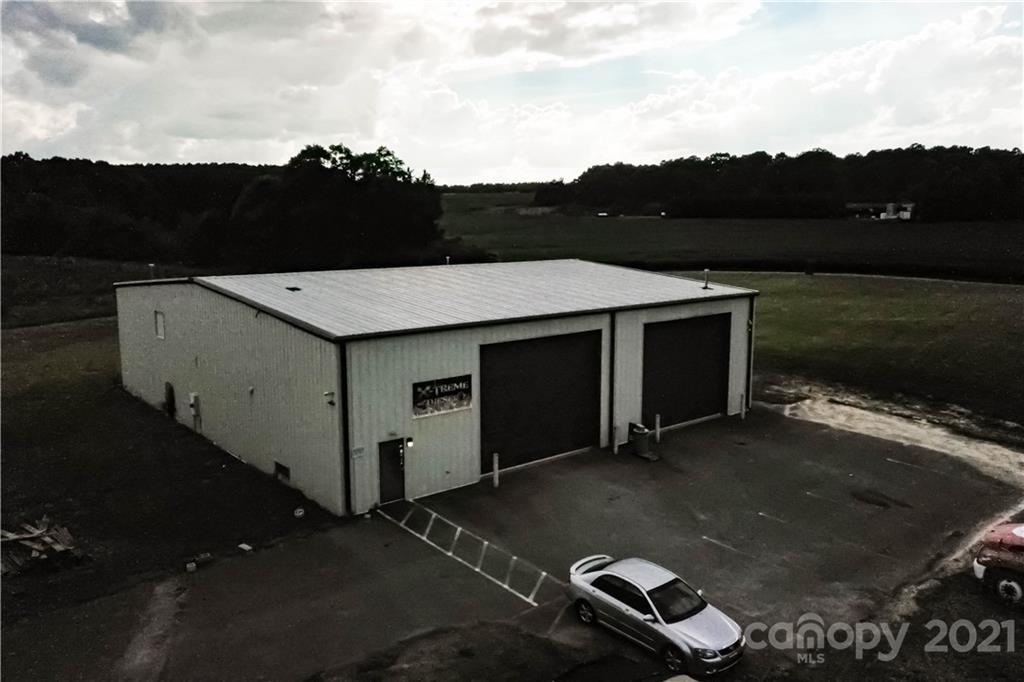 Commercial zoned property on busy Dallas Cherryville Highway! Over 5,000 square feet of garage space with 30 foot garage doors tandem. Inside office space and sleeping quarters. Restrooms. Current business is a large truck repair shop. Hundreds of thousands of dollars of equipment negotiable with purchase.