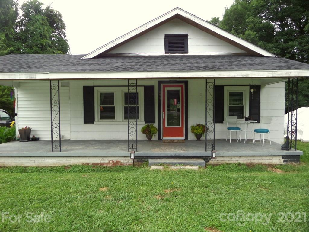 Ideal Flat Rock cottage awaits your finishing touches. Many upgrades and improvements, including new roof and soffits in 2020, Champion windows with transferrable lifetime warranty, newer kitchen, flooring, new water heater added in 2018, and bath improvements.  Home is also wired for a generator with plug near electric meter.  Abundant storage space is available in attic. Home boasts loads of soothing outdoor greenscape with level garden, playground/entertaining areas, or just sitting and relaxing in your own backyard.  Unused cart path frames right side of property (facing) and along with tree-lined edges provide privacy. Great location near shopping and amenities, and just five minutes plus to downtown Hendersonville. Seller is relocatin