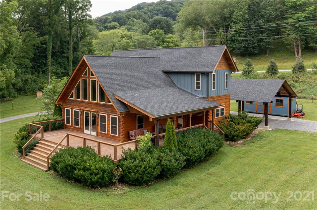 Your WNC dream property awaits! Located in the Beaverdam Valley of Haywood County, this gleaming 3/2.5 log home is situated on an incredible 5.5 level acres bordered by the bold and bubbling Beaverdam Creek. Unrestricted and ready to be used as a primary home, second home, vacation rental, homestead, hobby farm, or gentleman's estate. This home oozes comfort and mountain living with granite countertops, stainless steel appliances, a gas range, cathedral ceilings, and a cozy fireplace. An open floor plan awaits you with the master on the main, a walk-in closet, double vanity, and 2 bedrooms with a half bath upstairs. The 12 miles of hiking and mountain biking trails of the Rough Creek Watershed are only 1.5 miles from the house.  Minutes fro