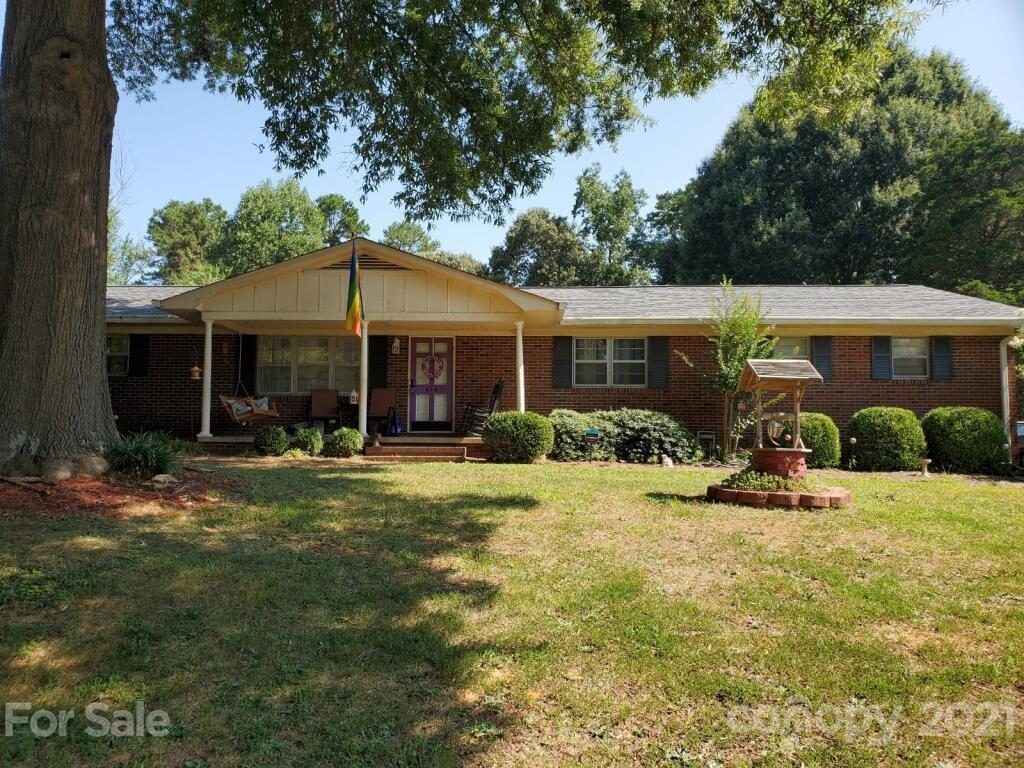 Make an  offer Today!  Rare to find... close to popular downtown Kannapolis! Approx 1.12 acre lot NO HOA! 3 Bedroom/2 Bath home plus...  full home size  Basement(lots of potential). Kitchen with Island,New Appliances & Wall Oven, Farmhouse Sink. Large Dining Room. No carpeting...Laminate Wood Flooring thru out home.  New AC 2015, New Roof & Gutters 2017, Electrical work 2019. Master Bedroom w/Bath, walk in closet. 2nd Bedroom has Slider Door to Backyard Deck area.  Living Room ambiance w/Fireplace Gas logs. 2nd Fireplace in Basement. Laundry/Pantry room.  Real big LOT w/2 Car Garage on Main Level, 1 Car Garage Downstairs. Private Well/Septic. Amazing backyard with Large Deck area for BBQ's,lifestyle activities and kids clubhouse in yard.