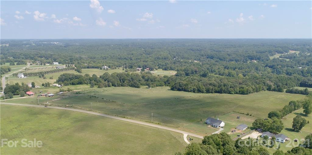 This is the location you've been looking for -- Mooresville Schools but only a couple miles from Davidson.  About as close to Davidson as you can get and still be in the Mooresville School District, and no city taxes.  Pristine farmland with views of rolling acreage all around.  Build your home on 5 acres with room for your shop, pool, a few horses, have your own mini estate or farm.  This farm is being sold as acreage sized tracts with only 8 tracts available, ranging from 5 acres to 14 acres, give or take.  No HOA.