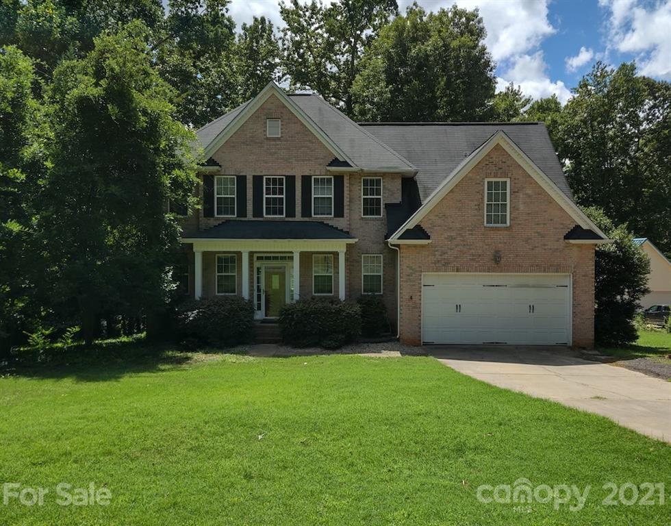 Brick front transitional boasts a bright open floor plan with hardwood floors, study with French doo