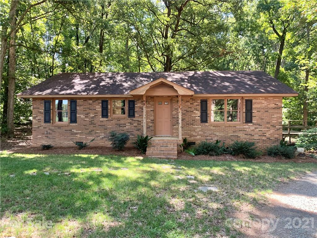 Charming brick ranch nestled on 5.3 aces in New Salem. Tucked in the trees you will find a lovely 3 bedroom 2 bathroom home. Out back is a wired workshop, with covered sheds on either side. The front of the property has both wooded and field areas.