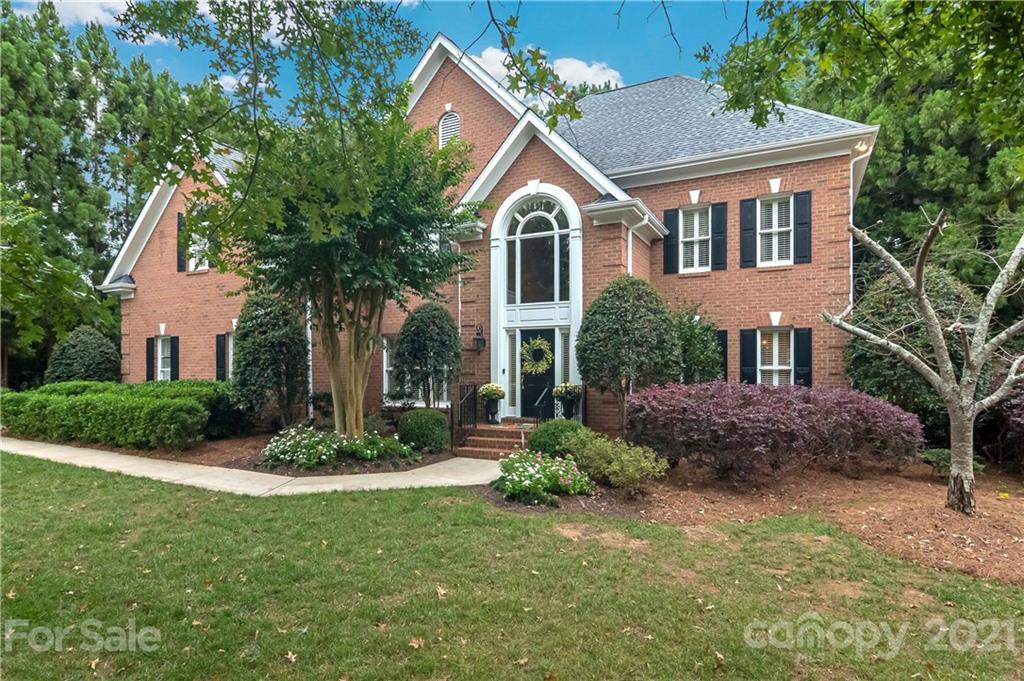 This neutral brick BCC home is on a flat, private lot with a brick terrace and fenced back yard. Ste