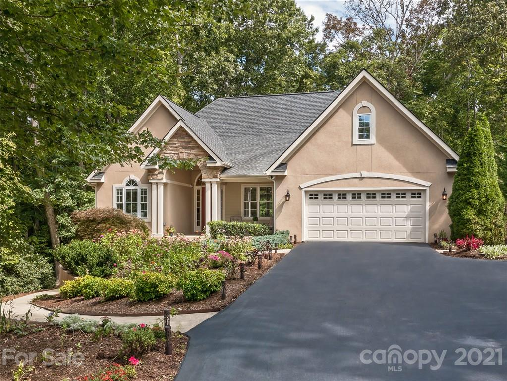 Enjoy private wooded & mountain views on 1.42 AC in prestigious Duncan Creek Estates, convenient to Avl/Hvl.  Quality, custom home built by renowned builder Paul Taylor w/ inviting front porch, magnificent 8' doors, cathedral ceilings, oversized windows, 4 season views.  Great room w/ cozy stone gas FP flows to spacious dining, perfect for gatherings.  Cook's kitchen w/breakfast room, quartz counters, island, tall cabinets, wall oven, gas cooktop & double pantries; all season sunroom; wraparound deck w/ gas hookup for easy, accessible grilling. Large primary suite w/dual vanity, huge glass enclosed shower, tub, private toilet room. French doors open to large walk-in closet w/ built-in storage system. Lounge w/ wet bar connects to large pati