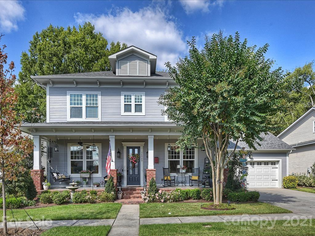 A charming front porch welcomes you to this beautiful, freshly painted craftsman style home w/ open