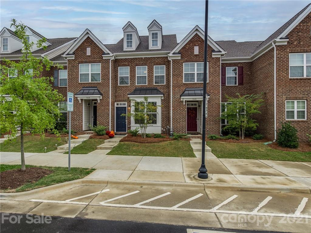 EXPECT TO BE IMPRESSED! Stunning Full Brick Townhome with Exquisite Upgrades - Walking Distance to R