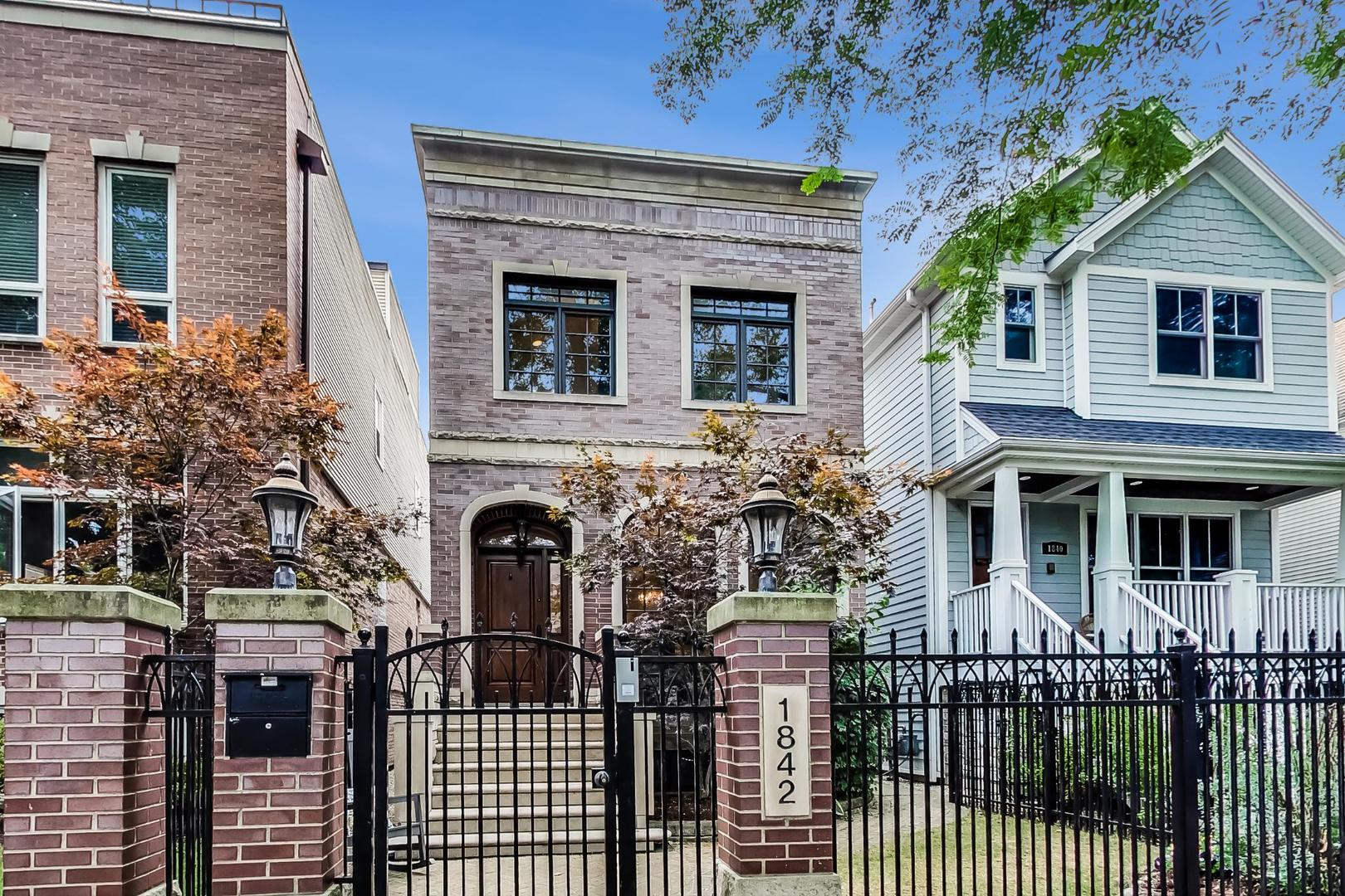 Roscoe Village luxury home on a quiet tree-lined street in an exclusive enclave. Stately limestone e