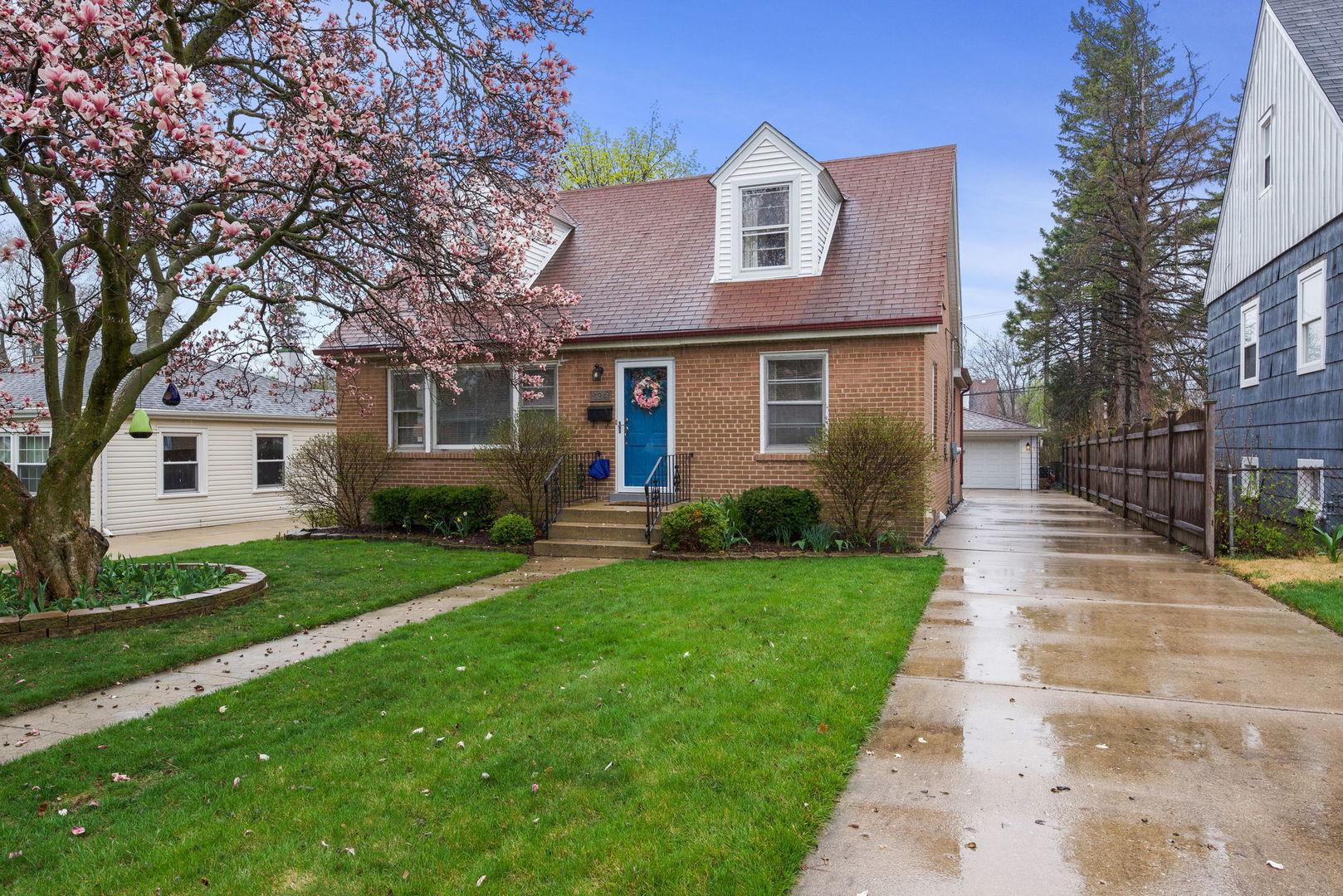 Love where you live in this brick beauty that offers updated Kitchen & baths! Hardwood floors, formal Dining Room, eat-in Kitchen with Quartz countertops & SS appliances, finished basement with dry bar, extra living space & storage.  2 Car garage,  landscaped yard.  Clean & well maintained!  Move-in Ready!  Convenient location - Walk to train & shopping.