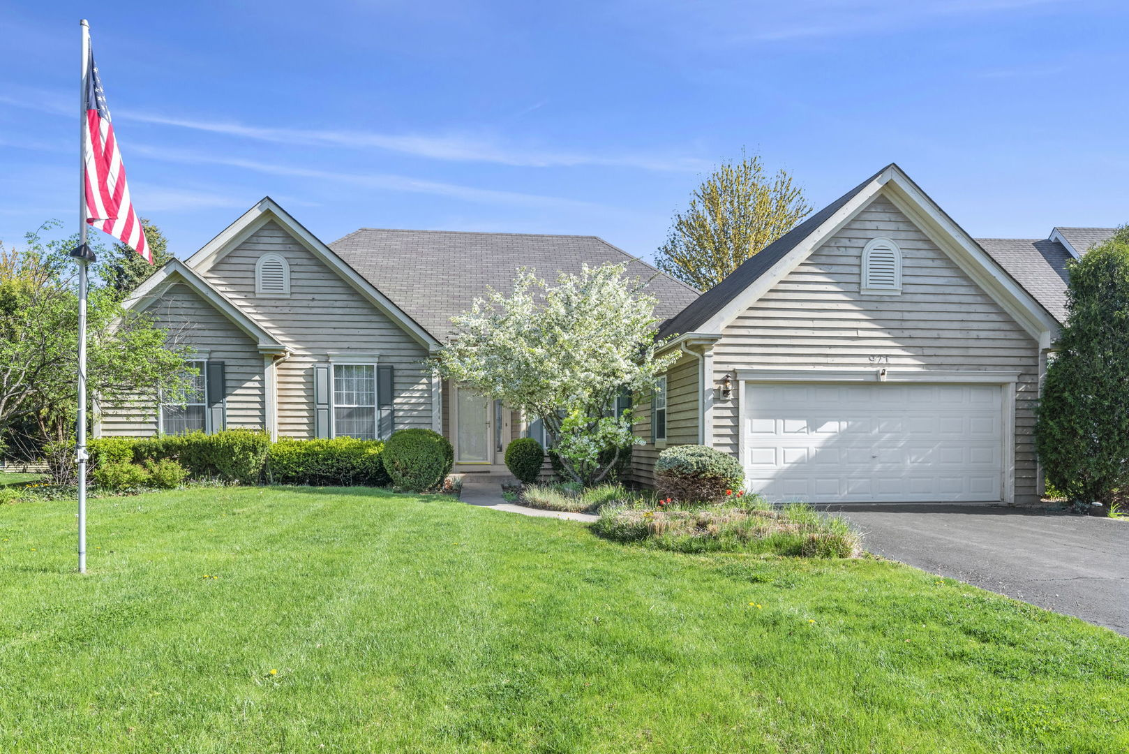 Spectacular Value! Sprawling ranch in desirable Hampton Hills subdivision is the BEST BUY IN TOWN!  Kitchen with ample white cabinetry, granite countertops, breakfast bar and eating area that walks out to a brick paver patio. Awesome 20x14 great room is light and bright and has vaulted ceilings, skylights and handsome WB fireplace. 15x11 formal dining room offers expansive table space. 3 nice sized main level bedrooms and 2 full baths. Master is 15x13 and has a walk in closet, oversized master bath with double sink, tub and separate shower. Main level laundry room and 2 car attached garage with direct entrance into home. Large unfinished basement can easily be converted to additional living space. Estate Sale: Property Sold As IS.
