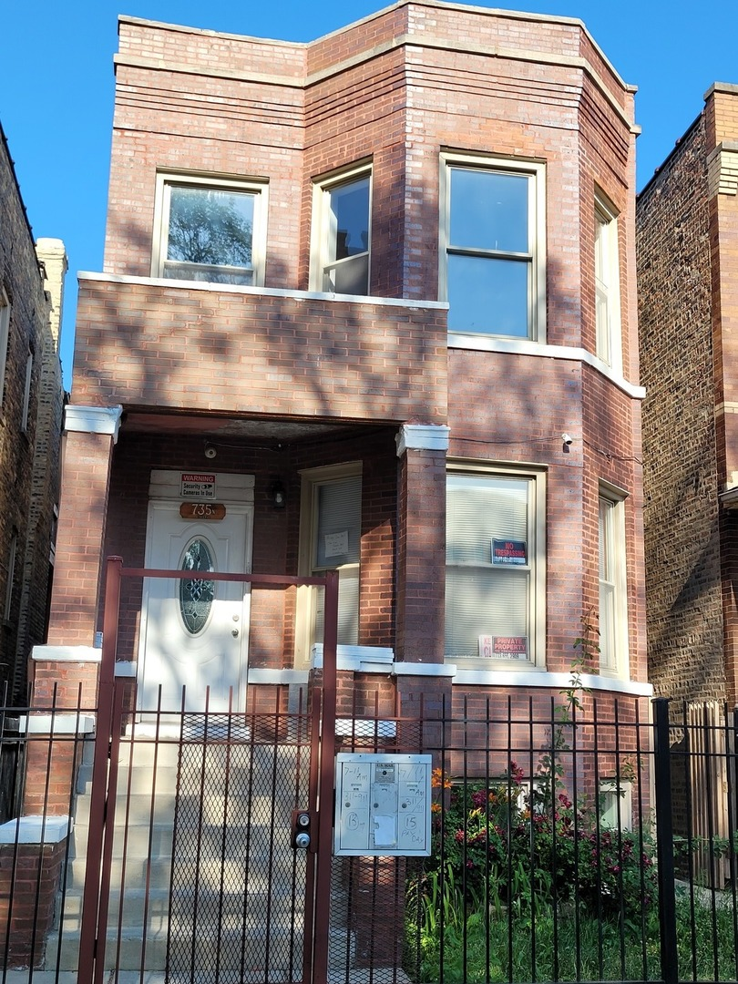 As Is! Very well kept 2 flat with separate utilities brick building in Humboldt Park.  Conveniently