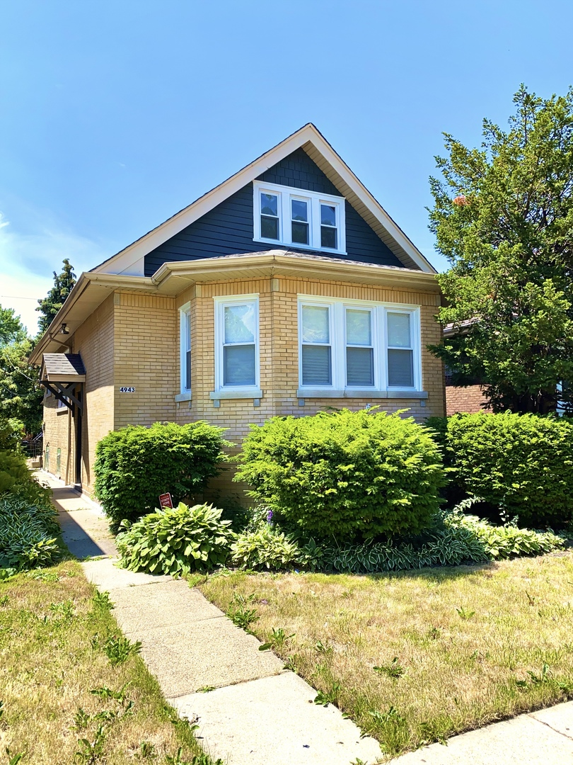 Beautiful yellow brick octagonal bungalow in Belmont Cragin. Plenty of space inside and outside of t