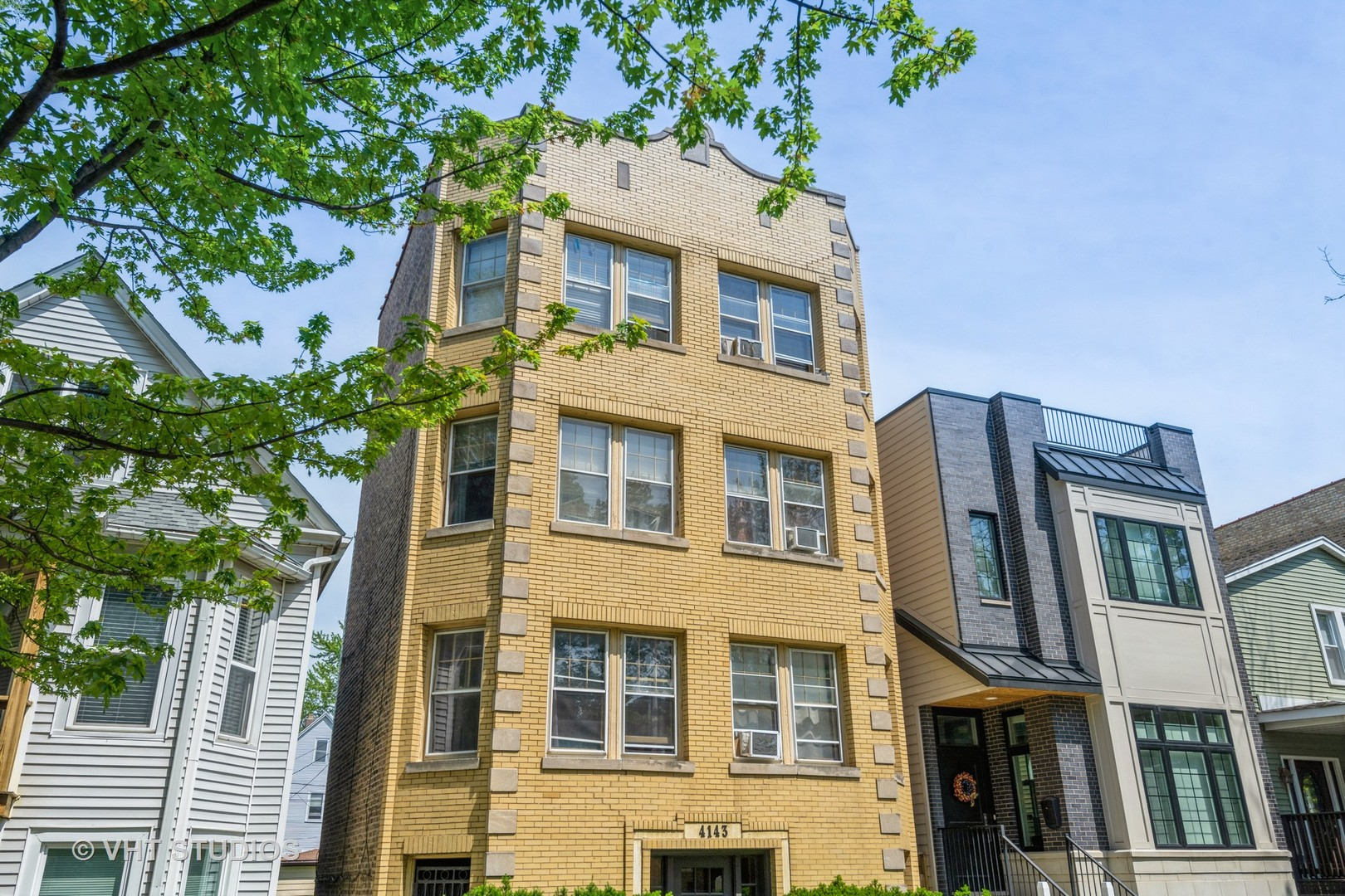 Solid All-brick legal 3-unit building in Old Irving Park East. Just amazing block with beautiful new