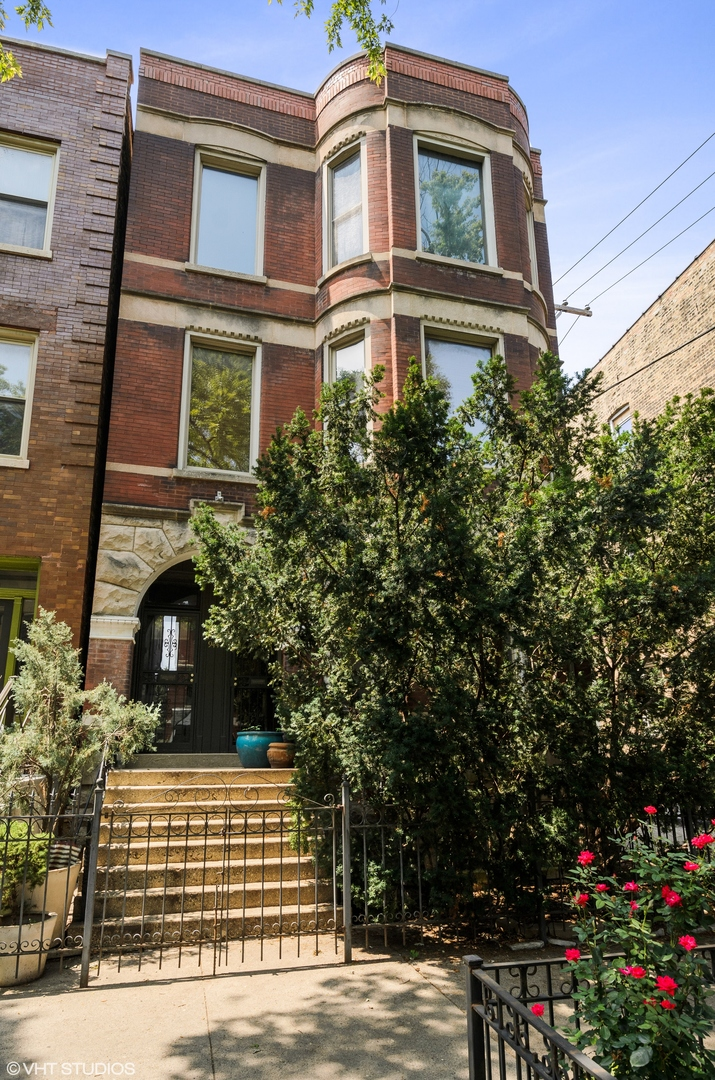 This stately brick and limestone building in Ukrainian Village offers a grand and unique 3-level own