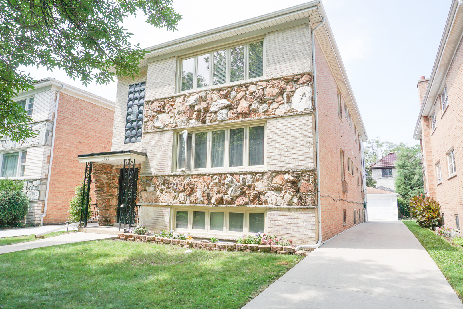 This one is a WOW! This completely updated Two Flat with side drive and finished basement is absolut