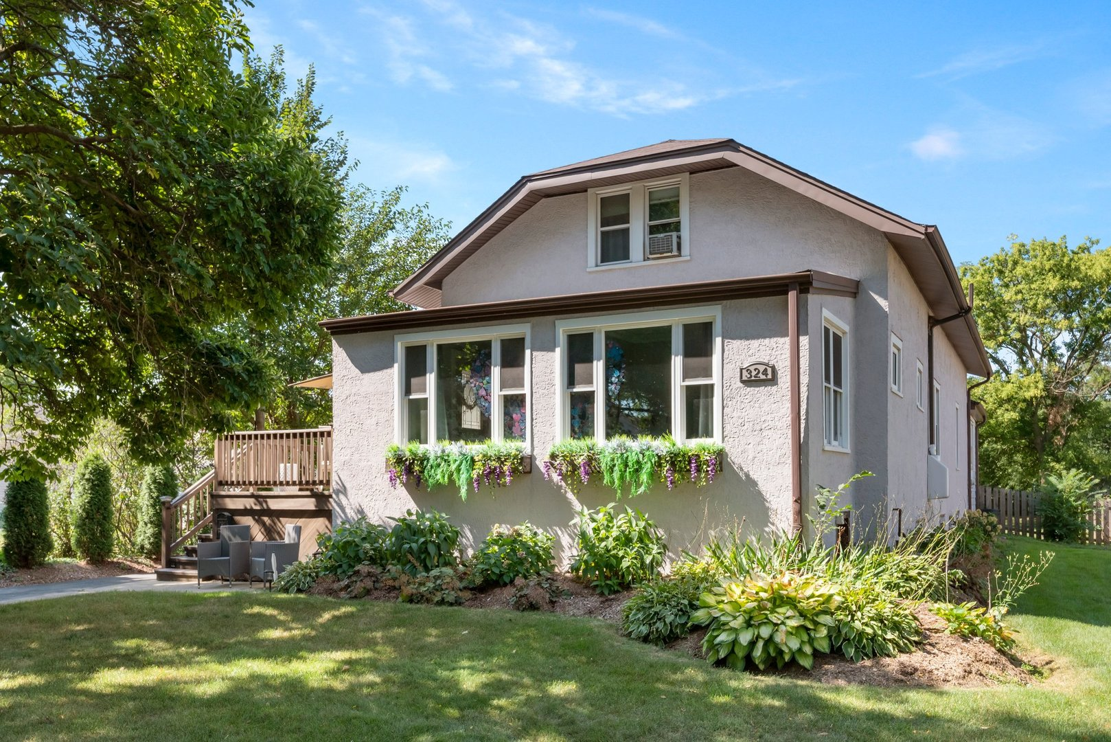 Craftsman style 5 bedroom bungalow on a massive 64x249 ft lot in ultra desirable South Villa Park location is an extreme value! The main  level is light and bright, has a terrific floor plan that features handsome hardwood flooring, plaster molding, white trim and replacement windows.  Beautiful front deck/porch walks into a mudroom opening to a sprawling living room and large formal dining area. 2 spacious 1st floor bedrooms and full bath.  Office area off of living room. Trendy and  ample sized kitchen leads to a 18x12 first level family room looking out to park like fenced rear yard.  The 2nd level has 3 bedrooms, 2nd full bath and awesome den/ entertainment room. Ginormous basement has a terrific rec area, laundry room, and tons of stor