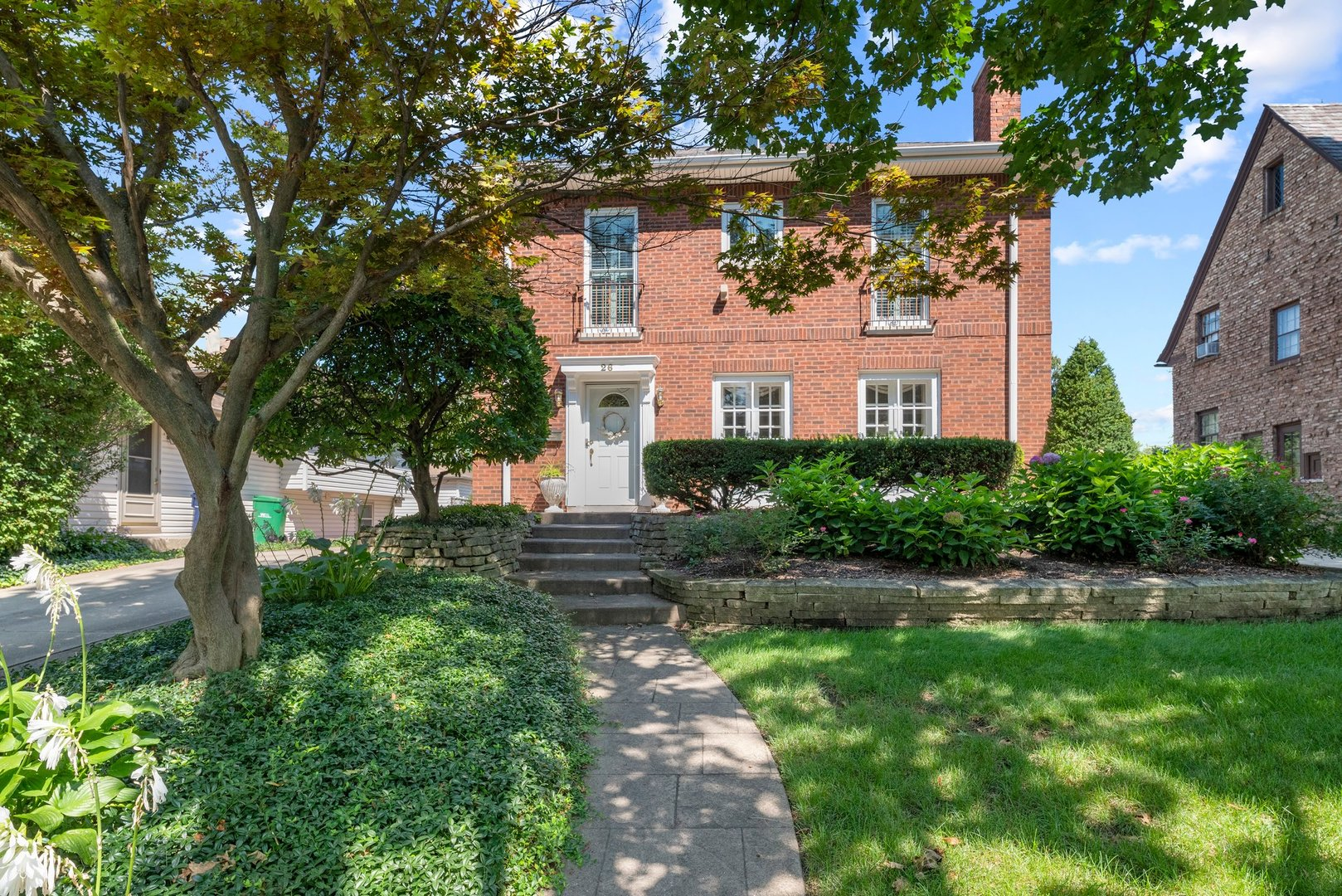"""Awesome Red Brick French Georgian on a tree lined street is just what you've been waiting for. Living room with hardwood floors and a wood burning fireplace. Separate dining room opens onto a Trek deck and brick patio. Office on the main floor plus 3 bedrooms upstairs. Stainless appliances. Large main bedroom has its own bath.  New Pella windows 2016 & 2019.  Full basement is partially finished. Hot water heat with space pac for air conditioning (2010). Just a few blocks from Pleasant Lane school. Bring your decorating ideas, this home is being sold """"as is"""" but has lots of charm!"""