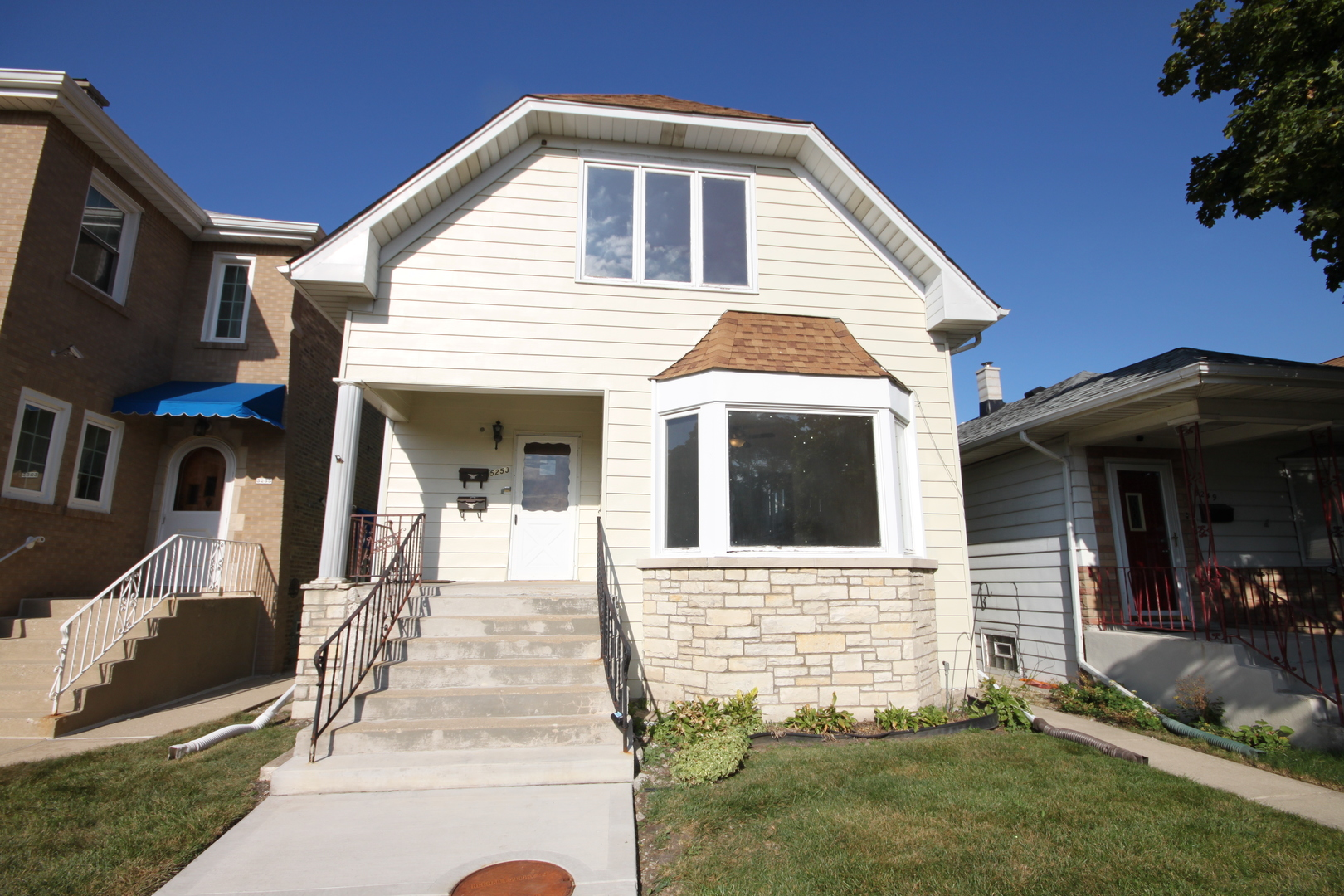 Spacious xtra wide 2 flat on 30 ft. wide lot on quiet tree lined street in Jefferson Park. Recently