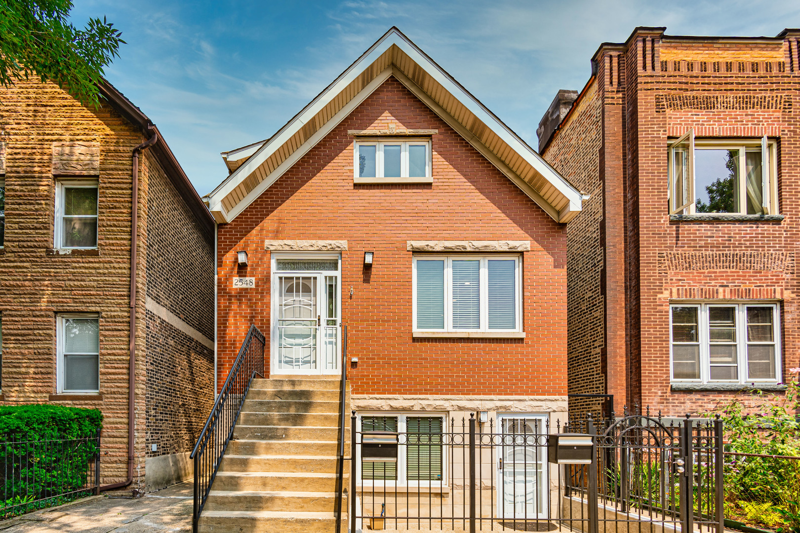 Sunny, updated property with a duplex up owner's unit and a high garden apt in Ukrainian Village/Smi