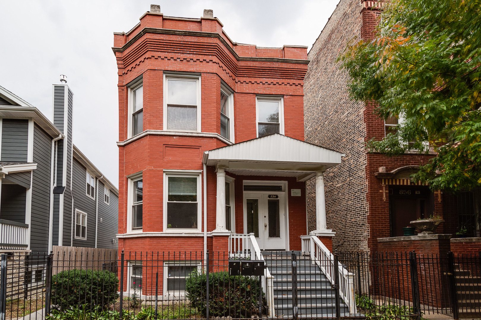 Brick 3-unit on an extra wide lot in great West Town location!   Two 3 bed/1 bath units with combine
