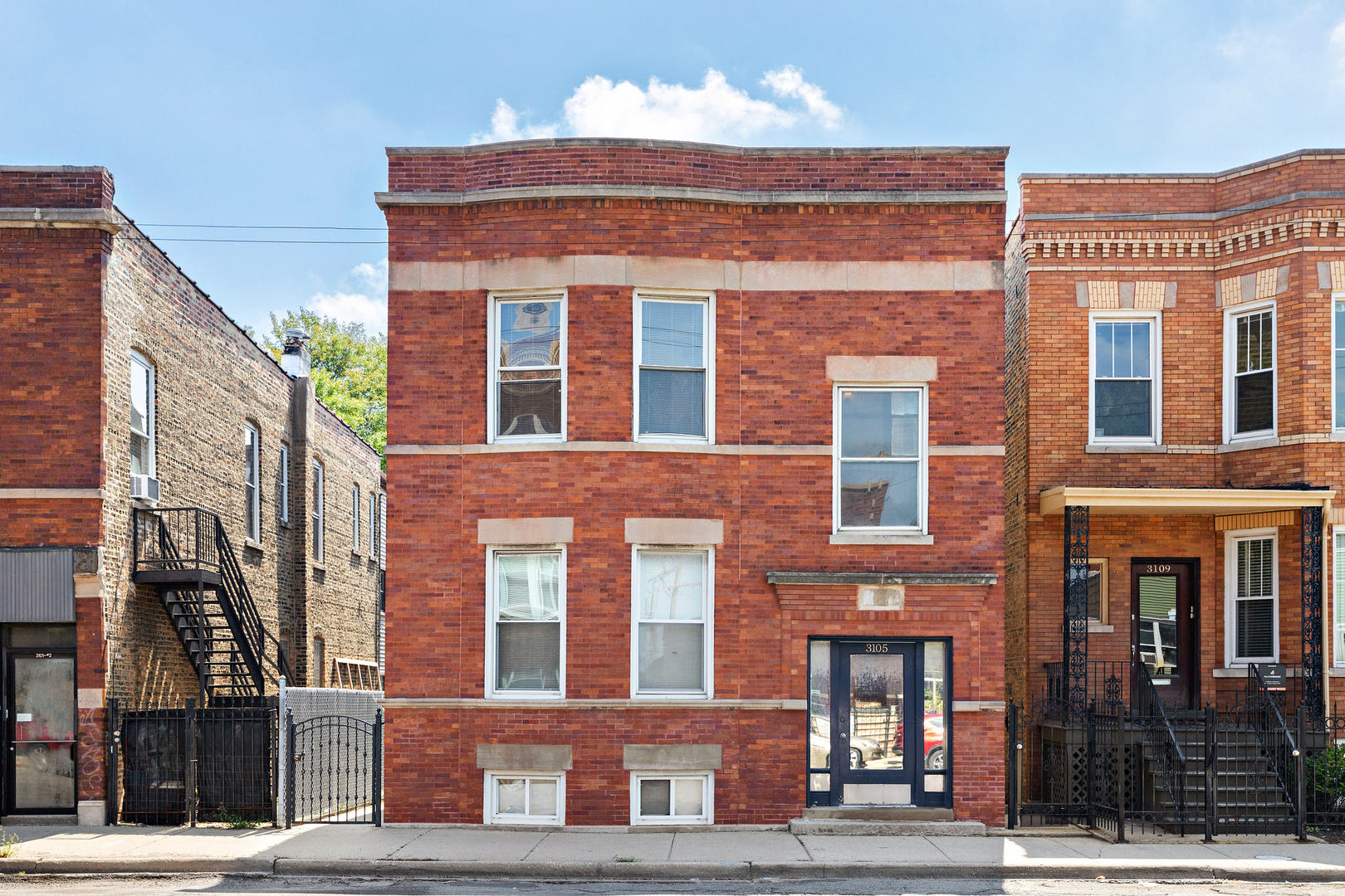 Invest with confidence in this incredible, jumbo Logan Square  4 Flat on an extra-wide lot! This bui