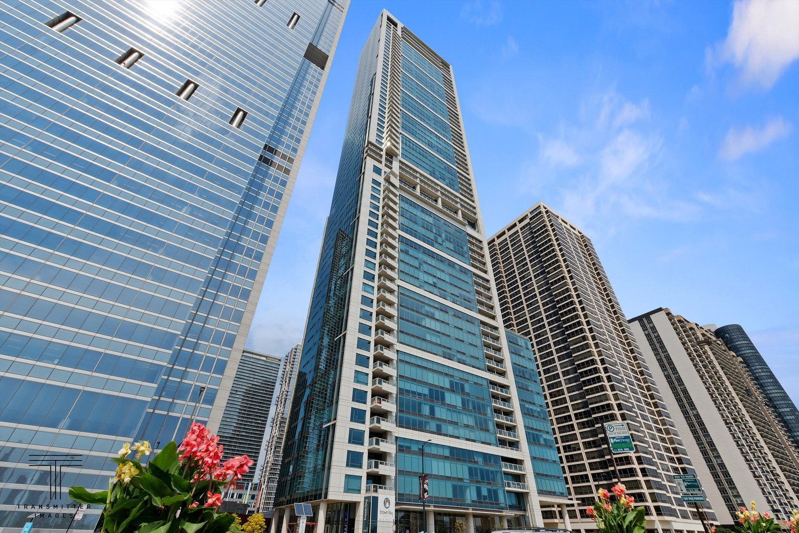 Beautiful home located in LakeShore East with City and Lake Views. Balcony overlooking the well-groo