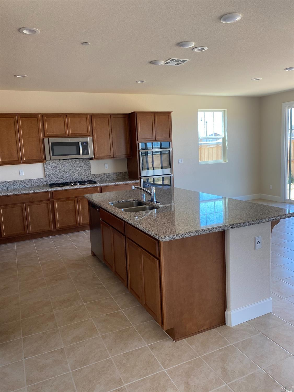 QUICK MOVE-IN: The exceptional ranch-style Janette plan boasts a private study, a spacious great roo