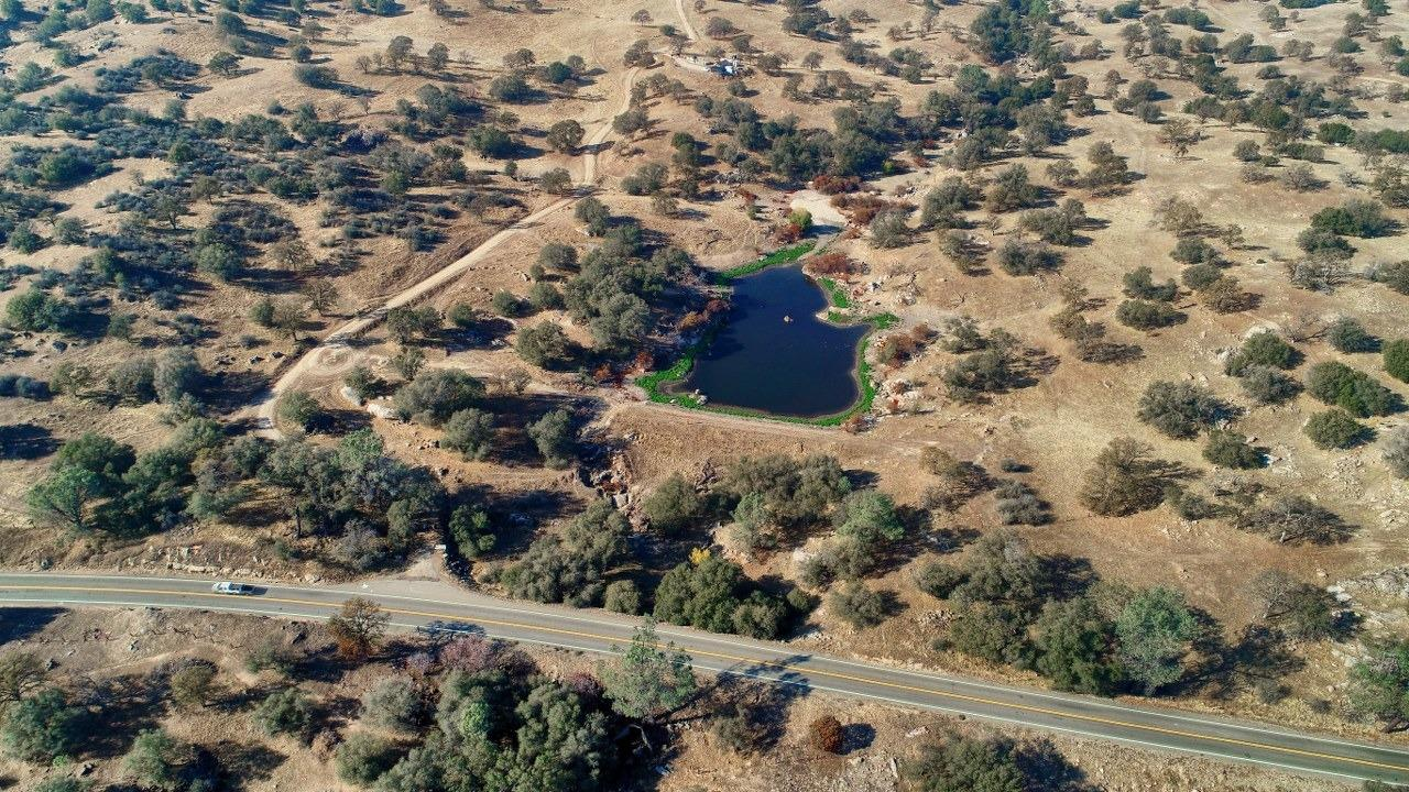 Beautiful 36.67+/- acres with a pond, power, well, lovely views and privacy! Enjoy all of this usable large acreage and come and see where your new dream home could be and imagine the possibilities! Located close to Highway 41 for an easy commute to Fresno and close to Yosemite National Park. This a great spot for your family with plenty of room to build a barn or a workshop with lots of room to roam. This is wonderful area if you want horse property or ride ATVs in a beautiful setting! (Agent to accompany, difficult to locate exact location of property.)